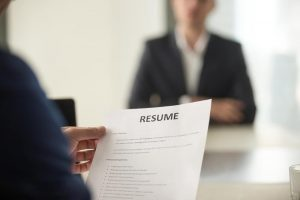 Close up of man holding resume